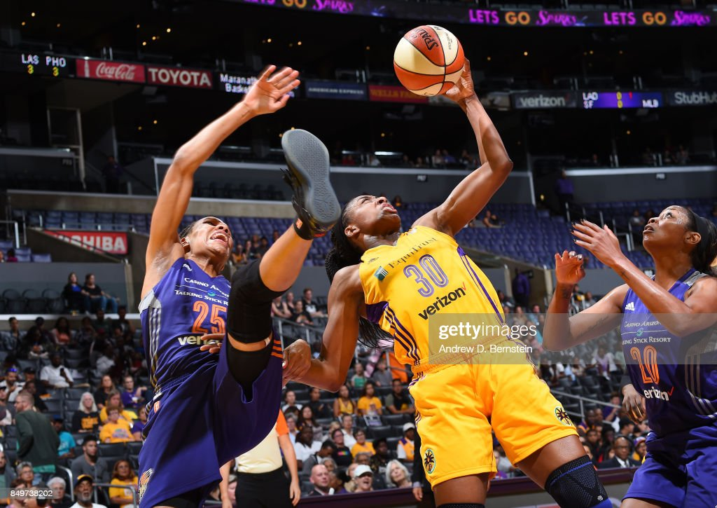 Nneka Ogwumike #30 of the Los Angeles Sparks shoots the ball against Monique Currie #25 and Camille Little #20 of the Phoenix Mercury in Game One of the Semifinals during the 2017 WNBA Playoffs on September 12, 2017 at STAPLES Center in Los Angeles, California.