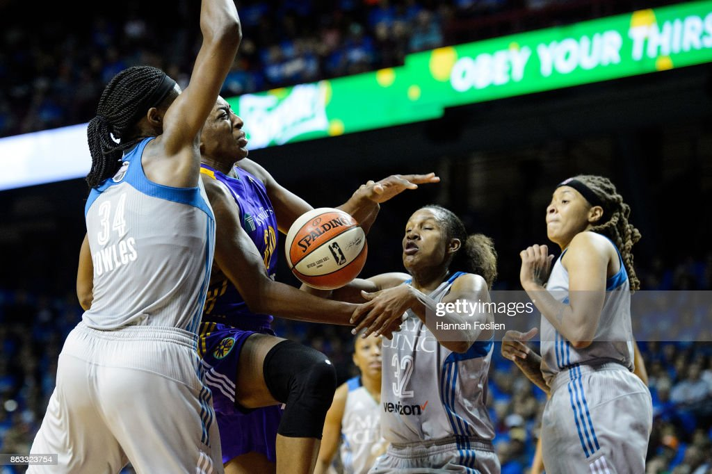 Nneka Ogwumike #30 of the Los Angeles Sparks shoots the ball against Sylvia Fowles #34 and Rebekkah Brunson #32 of the Minnesota Lynx during the third quarter of Game Two of the WNBA Finals on September 26, 2017 at Williams in Minneapolis, Minnesota. The Lynx defeated the Sparks 70-68.