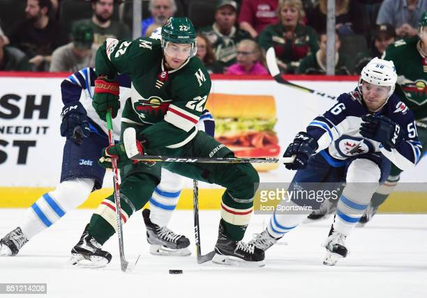 nnesota Wild right wing Nino Niederreiter protects the puck during a preseason NHL game between the Minnesota Wild and Winnipeg Jets on September 21...