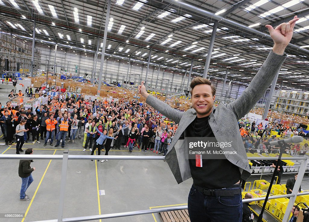 UK No. 1 selling artist <a gi-track='captionPersonalityLinkClicked' href=/galleries/search?phrase=Olly+Murs&family=editorial&specificpeople=6350751 ng-click='$event.stopPropagation()'>Olly Murs</a> Performs and meets the workforce at Amazon's Fulfilment Centre in Hemel Hempstead as part of Black Friday Deals Week on November 24, 2014 in Hemel Hempstead, England.