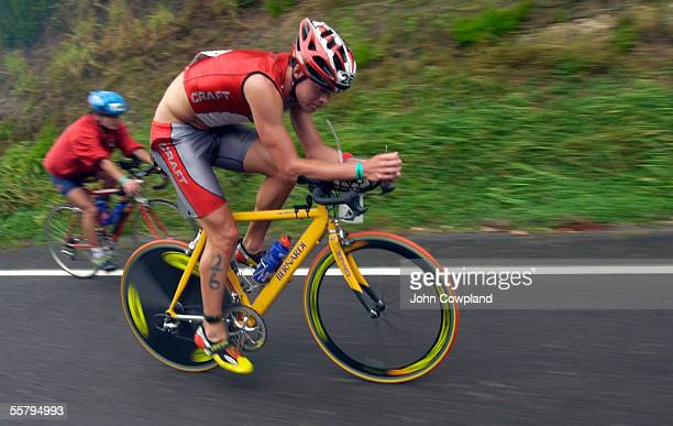 No 26 Jonas Coulting from Sweden grinds it up hill on the cycle leg during the Air New Zealand Ironman New Zealand triathlon held in and around Lake...