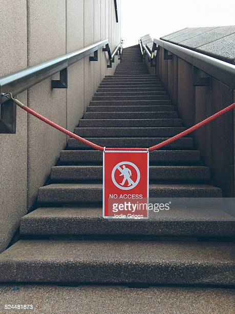 'No Access' sign hanging in front of stairs