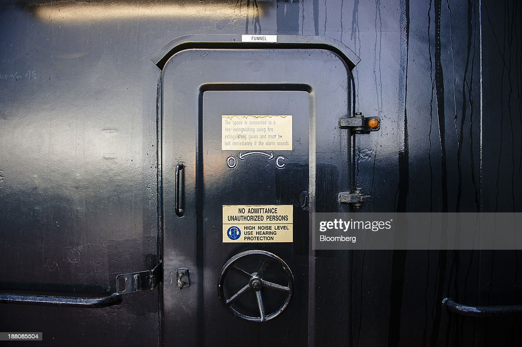 A 'No Admittance' sign sits on a closed access door to one of the ship's funnels aboard the Maersk Mc-Kinney Moeller Triple-E Class container ship, operated by A.P. Moeller-Maersk A/S, as it sails on the North Sea between Rotterdam in the Netherlands and Bremerhaven, Germany, on Monday, Nov. 11, 2013. A.P. Moeller-Maersk A/S's container-shipping line, the world's largest, reported an 11 percent increase in third-quarter profit after cost cuts countered a decline in freight rates. Photographer: Kristian Helgesen/Bloomberg via Getty Images