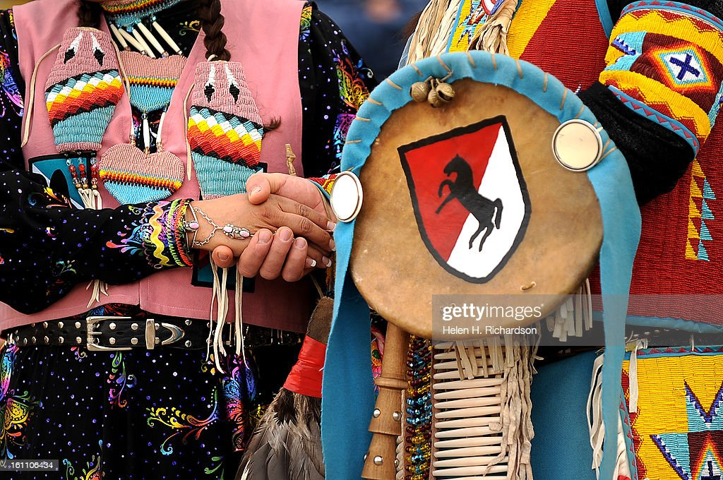 AJ No Braid an Arikaree left and her husband Asay No Braid a Lakota right show off their traditional hand beaded costumes while they perform a...