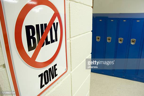 No Bullying Sign Located in School Hallway with Lockers