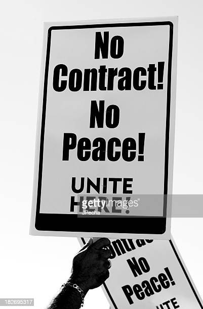 No Contract Sign Held by Hand in Protest Close Up