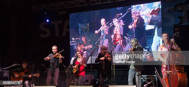 No Crows Felip Carbonell Oleg Ponomarev Anna Houston Steve Wickham Ray Coen Eddie Lee perform on stage at the Fleadh Cheoil 2014 Day 8 at the Gig Rig...