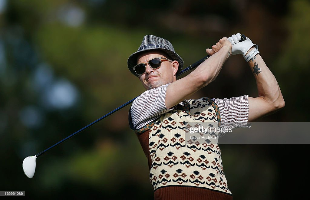 No Doubt drummer <a gi-track='captionPersonalityLinkClicked' href=/galleries/search?phrase=Adrian+Young&family=editorial&specificpeople=213613 ng-click='$event.stopPropagation()'>Adrian Young</a> hits a tee shot during the final round of ARIA Resort & Casino's Michael Jordan Celebrtiy Invitational golf tournament at Shadow Creek on April 7, 2013 in North Las Vegas, Nevada.