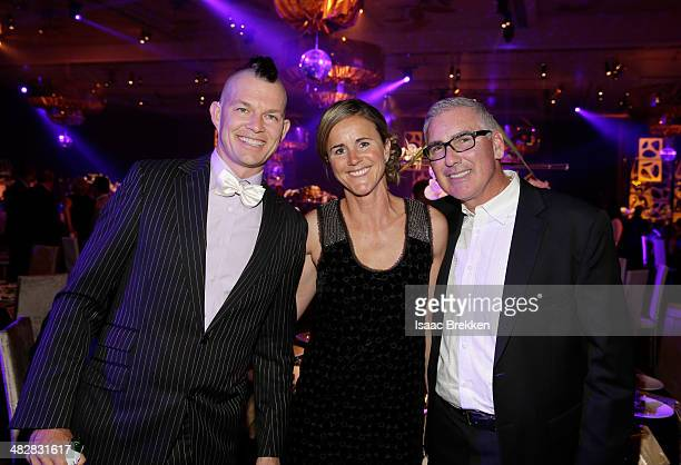 No Doubt drummer Adrian Young soccer player and broadcaster Brandi Chastain and husband Jerry Smith attend the 13th annual Michael Jordan Celebrity...