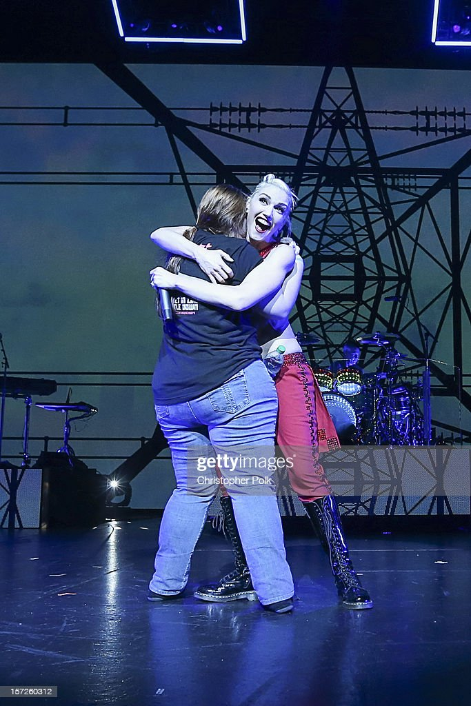 No Doubt's Gwen Stefani gets a hug from a fan as she performs at Gibson Amphitheatre on November 30, 2012 in Universal City, California.