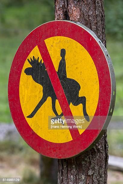 No elk riding sign