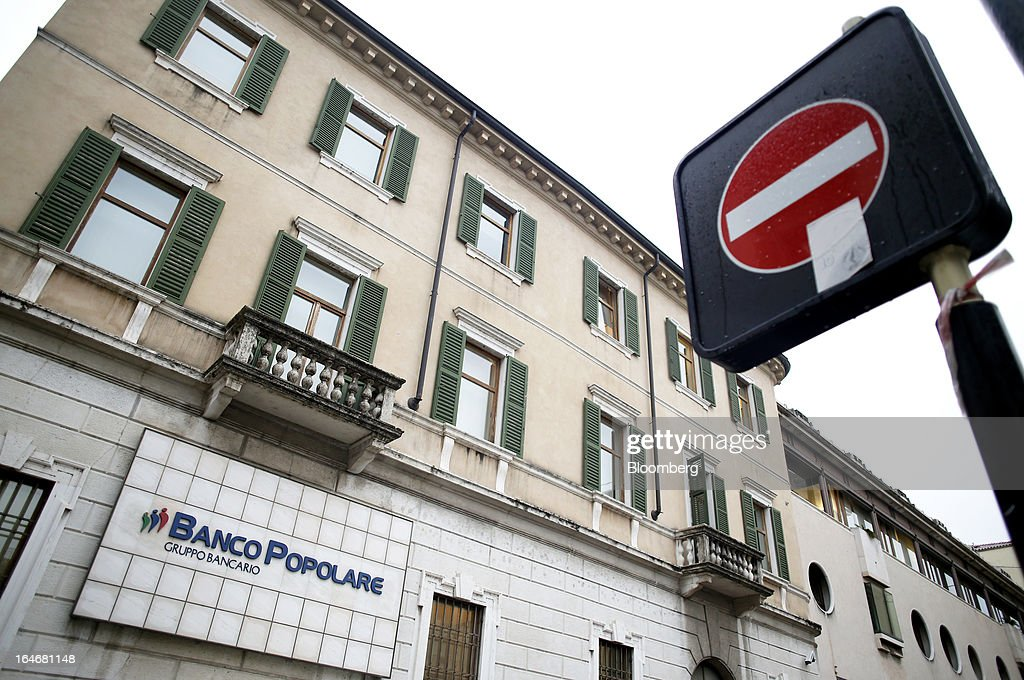 A 'No entry' road sign stands opposite the headquarters of Banco Popolare SC in Verona, Italy, on Monday, March 25, 2013. Italy's economy remains mired in its longest recession in two decades and a month-old political impasse threatens to increase sovereign-debt yields and bank funding costs. Photographer Alessia Pierdomenico/Bloomberg via Getty Images