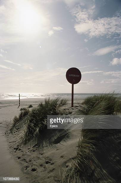 A no entry sign placed in a sand dune at Dyfi nature reserve near Aberystwyth Ceredigion September 1982