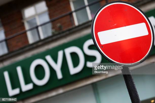 A no entry traffic sign stands near a Lloyds bank branch a unit of Lloyds Banking Group Plc in London UK on Wednesday May 31 2017 Lloyds is in talks...