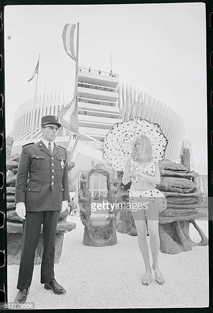 No Heed Montreal Canada This Expo 67 guard certainly has no reason to frown Sabrina from the French Pavilion here is trying out her new bikini plus...