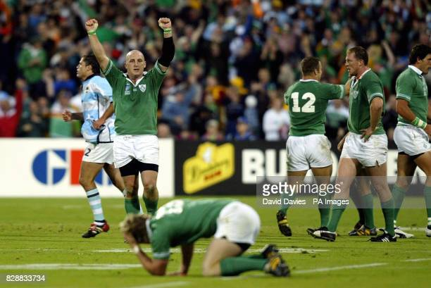 No mobile phone use Internet sites may only use one image every five minutes during match Ireland's captain Keith Wood raises his arms at the final...