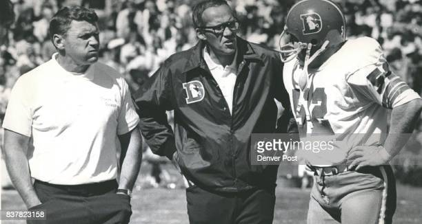 No Mutual Admiration Society for the moment Bronco Defensive Line Coach Stan Jones left glowers as Linebacker Coach Joe Collier and Fred Forsberg...