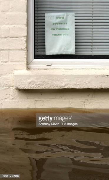 A no parking sign is displayed in a window on Alney Terrace close to the river Severn in Gloucester