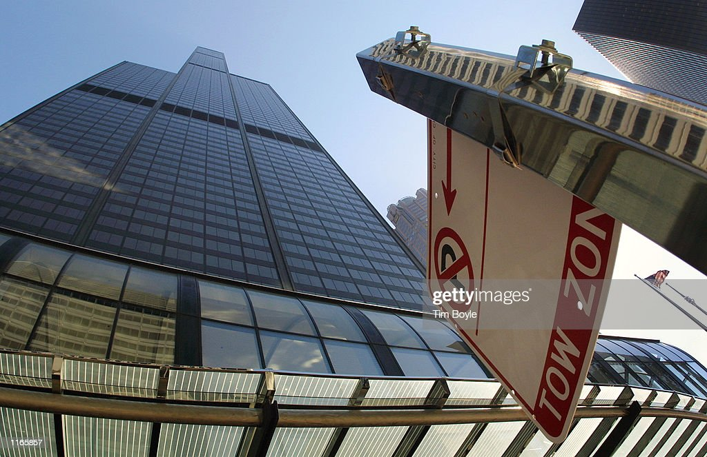 A 'No Parking' sign is visible outside the west facade of the Sears Tower October 3 2001 in Chicago At 1450 feet the Sears Towers is the tallest...