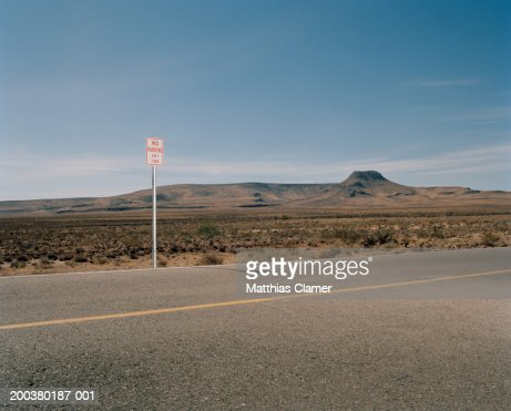 'No Parking' sign on desert road : Stock Photo