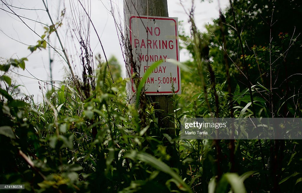 A 'No Parking' sign stands amidst overgrowth in the Lower Ninth Ward on May 12 2015 in New Orleans Louisiana The area was heavily damaged during...