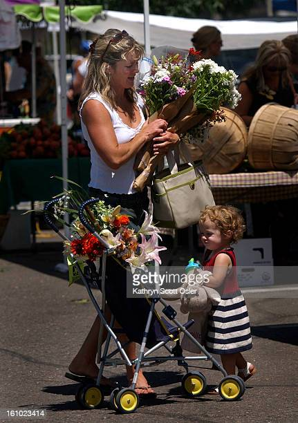 DENVER CO AUGUST 4 2004 No room to ride Twentythree month old Hallie<cq> Orear<cq> walks through the Cherry Creek Farmers' Market<cq> with her mother...