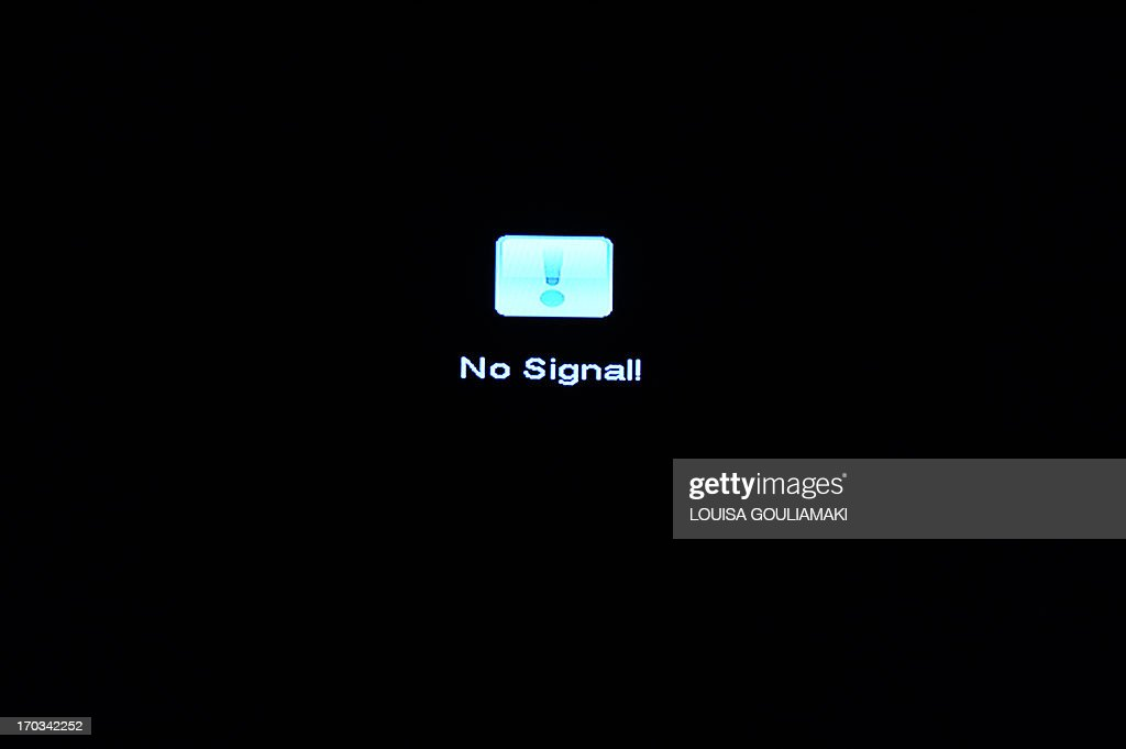 A 'no signal ' sign appears on the public ERT, NET and ERT3 broadcasters channels, after Greece's government suspended state television and radio broadcaster ERT, in a shock move on June 11, 2013 that affects nearly 2,700 jobs. Hundreds rushed to the main premises of ERT in the northern Athens suburb of Agia Paraskevi to show their support, shortly after the announcement made by government spokesman Simos Kedikoglou. The government announced that channels will shut down at midnight - after that the screens will go black.