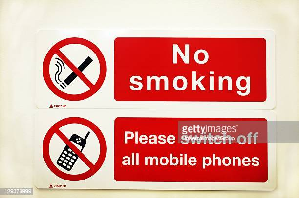 No smoking and mobile phones signs