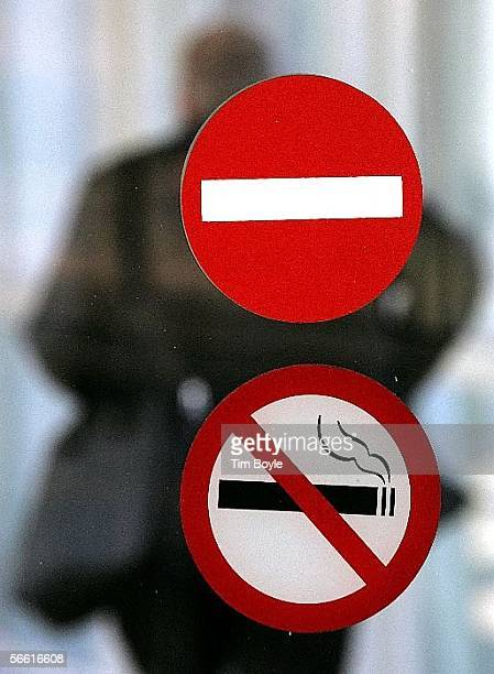A 'no smoking' logo is seen below an international 'do not enter' symbol on a door at O'Hare International Airport January 18 2006 in Chicago...