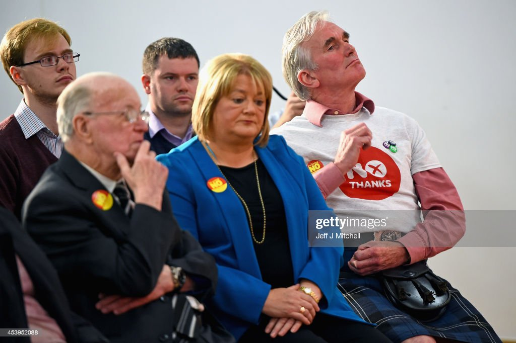 'No' supporters listen to Gordon Brown former British Prime Minister give his keynote speech during an event to mark the beginning of the last four weeks of the campaign on August 22, 2014 in Glasgow,Scotland. Both camps in the referendum campaign are holding events on the first day of purdah, a 28 day period which curbs what public bodies can do during the election period.