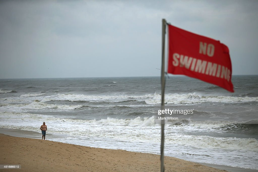 No swimming flags are posted due to the heavy surf left by Hurricane Arthur, July 4, 2014 in Nags Head, North Carolina. Hurricane Arthur hit North Carolina's outer banks overnight causing wide spead power outages, flooding and damage, and has since weakened to a Category 1 as of Friday morning.