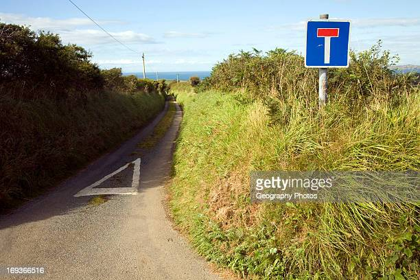 No through road sign and country lane Trefin Pembrokeshire Wales