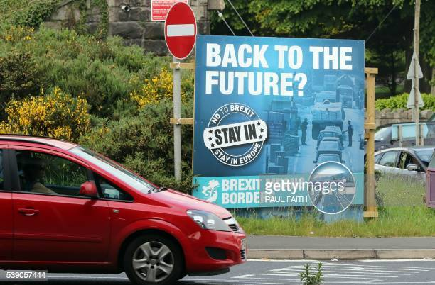 A 'No To Brexit' sign is pictured on the outskirts of Newry in Northern Ireland on June 7 2016 The border that divides the island of Ireland is now...