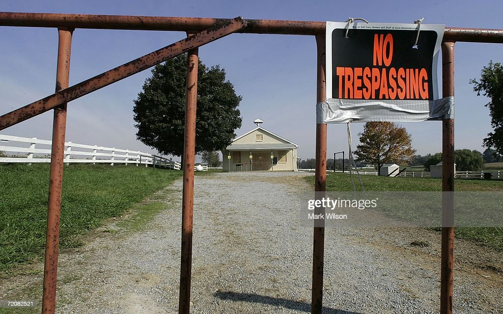 A 'No Trespassing' sign hangs on a fence in front one room Amish school house where five girls were murdered October 4 2006 in Nickel Mines...