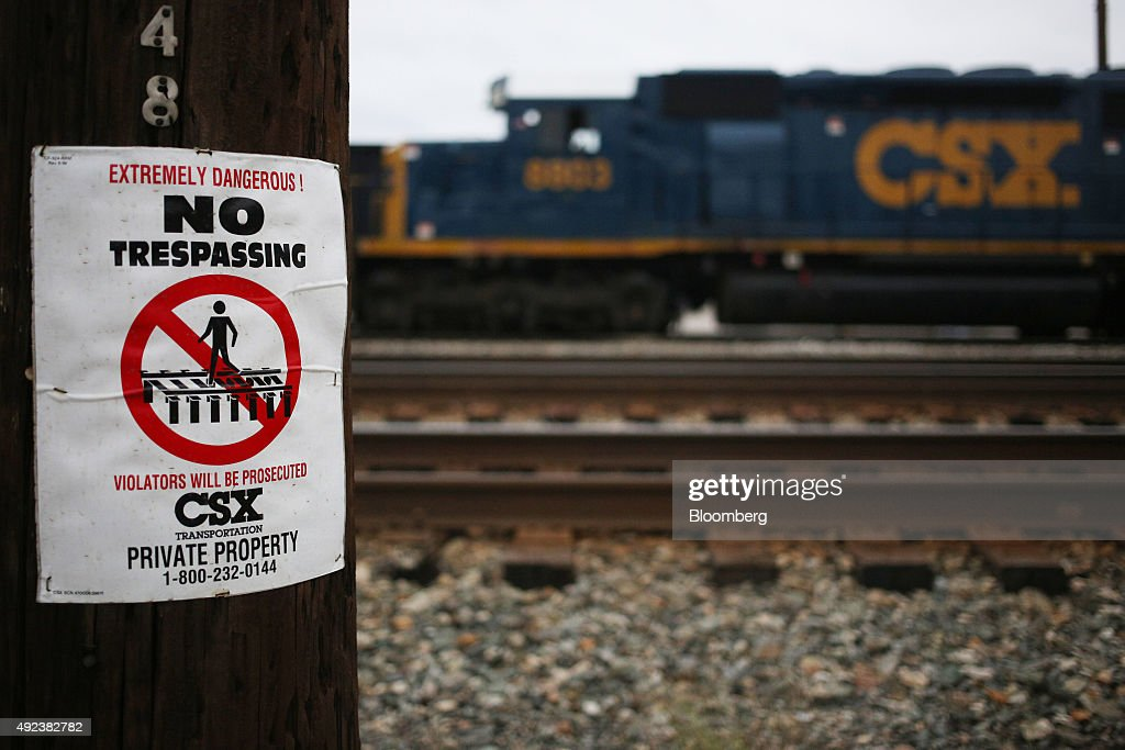 A 'no trespassing' sign is displayed along the railroad tracks outside the CSX Corp Huntington Shop in Huntington West Virginia US on Wednesday Sept...