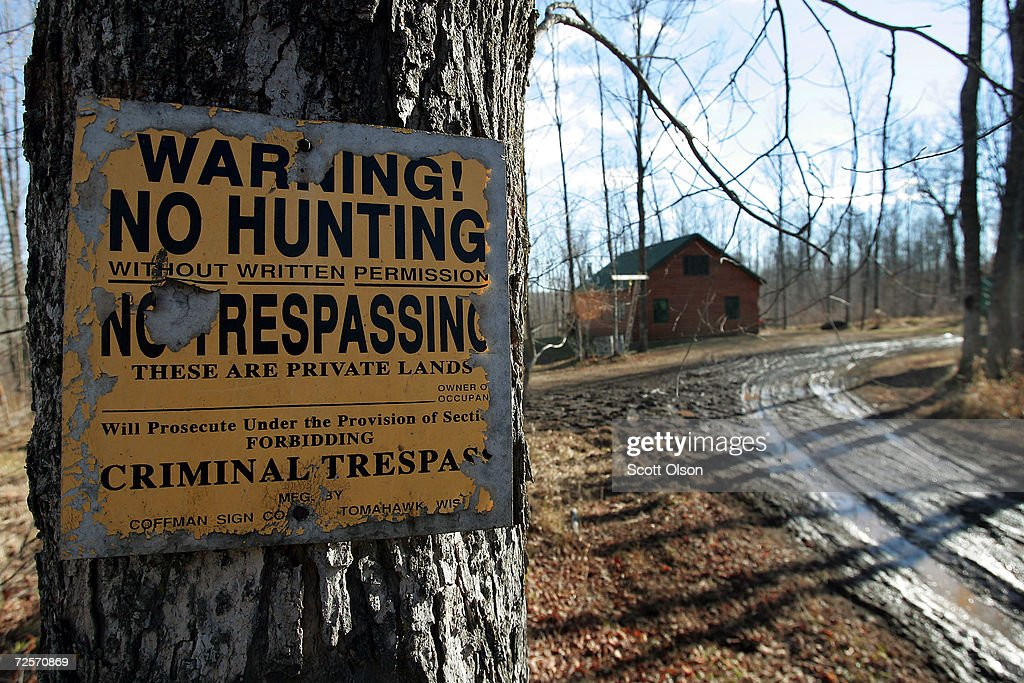 A 'no trespassing' sign is nailed to a tree near the hunting cabin of Robert Crotteau November 23 2004 in Meteor Township Wisconsin Crotteau his son...