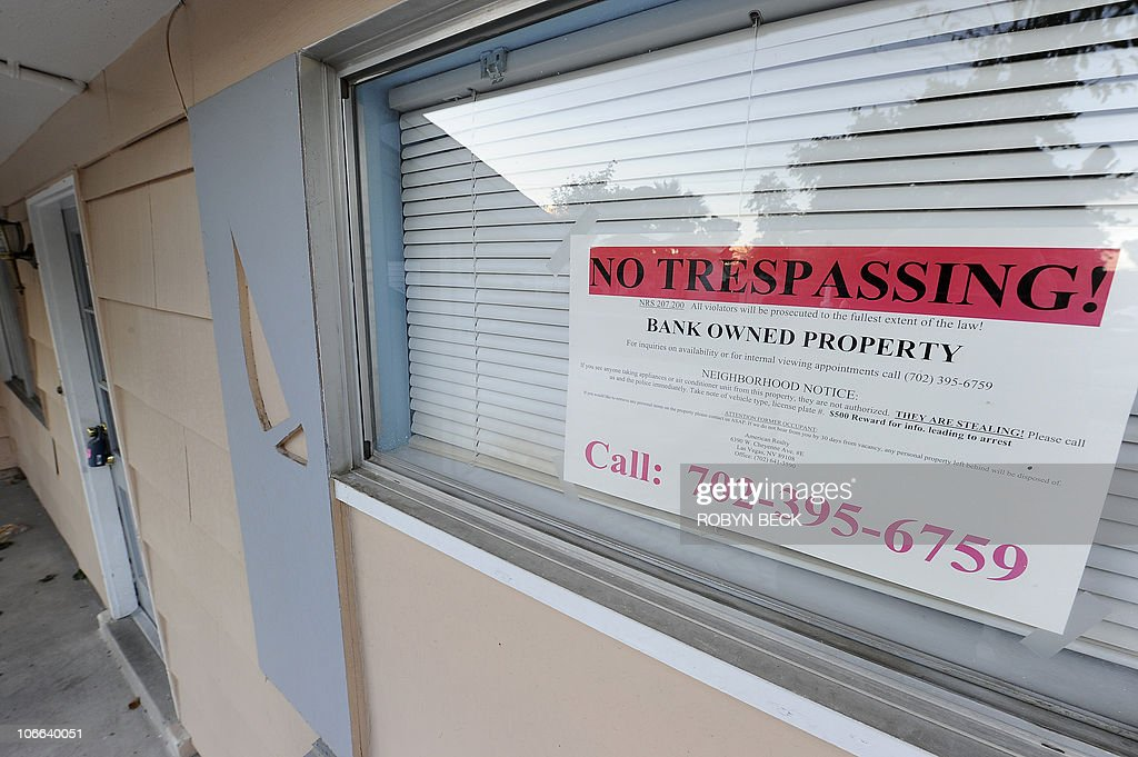 A 'No Trespassing' sign is seen in the window of a bankowned home in Las Vegas Nevada November 8 2010 Almost a month has passed since top government...