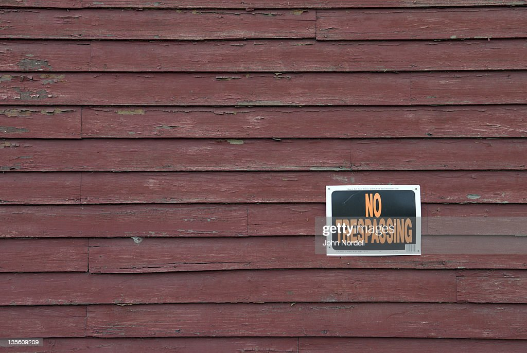 No Trespassing sign on side of an old building