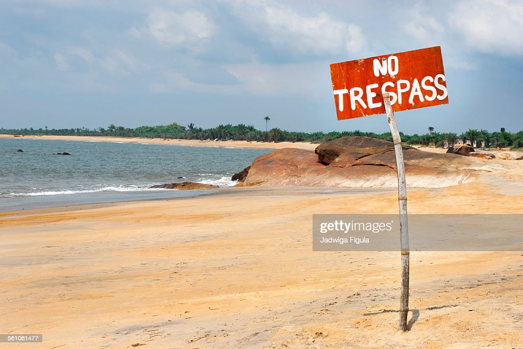 No trespassing sign on the beach in Liberia.