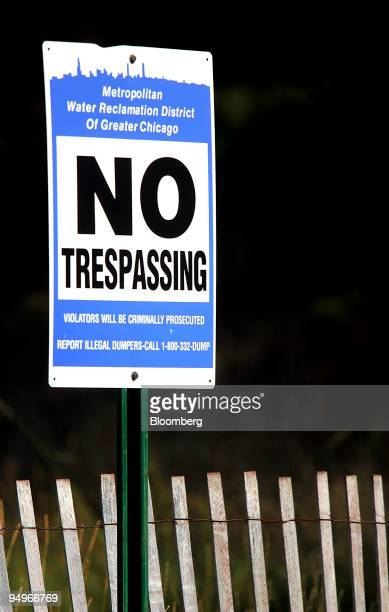 A 'No Trespassing' sign stands outside the Metropolitan Water Reclamation District of Greater Chicago Stickney Water Reclamation Plant in Stickney...