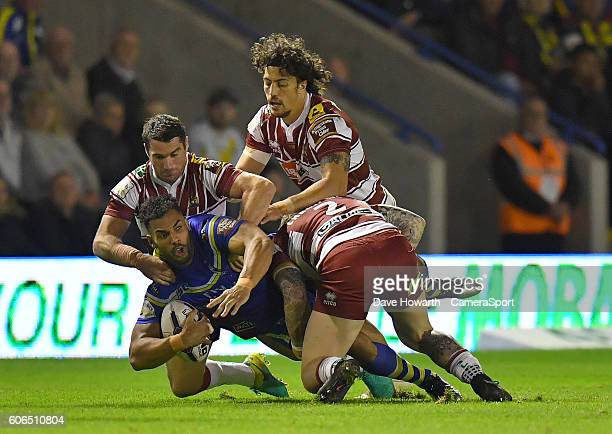 No way past the Wigan Warriors defence for Warrington Wolves' Ryan Atkins during the First Utility Super League Super 8s Round 6 match between...