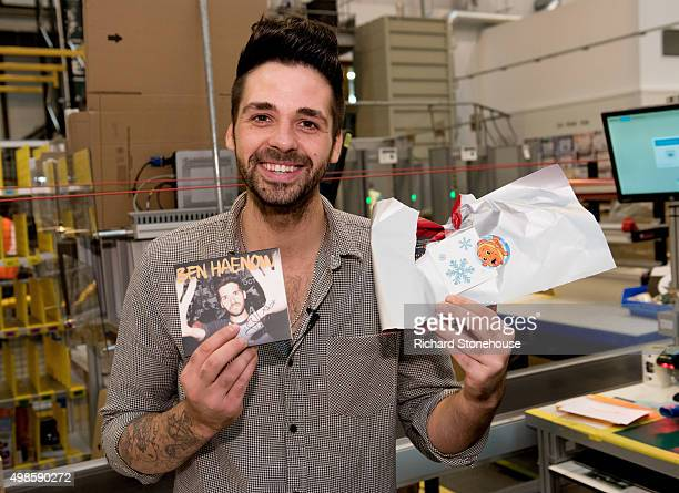 No1 selling artist Ben Haenow tries to gift wrap a signed CD after performing at Amazon Fulfilment Centre in Peterborough as part of AmazoncoukBlack...