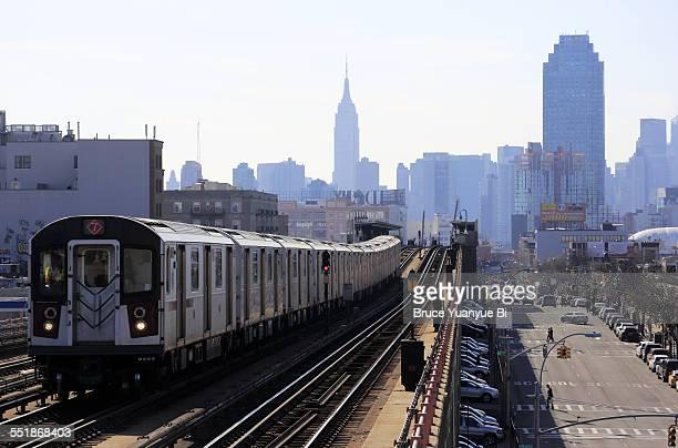 No.7 elevated subway train with Manhattan skyline
