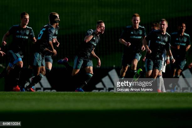 Noa Lang of AFC Ajax celebrates scoring their opening goal during the UEFA Youth League Quarter Final match between Real Madrid CF and AFC Ajax at...