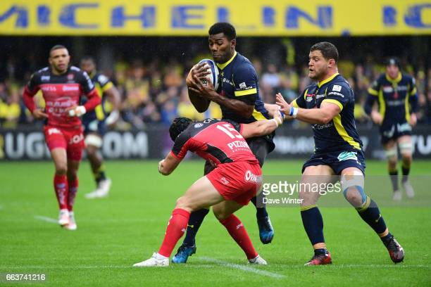 Noa Nakaitaci of Clermont takes on Leigh Halfpenny of Toulon under the watchful eyes of Benjamin Kayser of Clermont during the European Champions Cup...