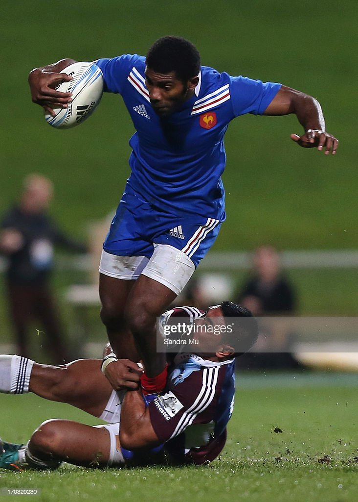 Noa Nakaitaci of France is tackled during the tour match between the Auckland Blues and France at North Harbour Stadium on June 11, 2013 in Auckland, New Zealand.