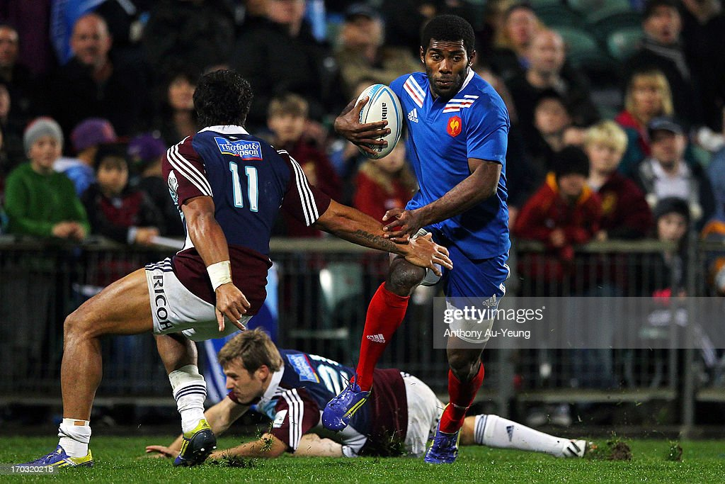 Noa Nakaitaci of France makes a run at George Moala of the Blues during the tour match between the Auckland Blues and France at North Harbour Stadium on June 11, 2013 in Auckland, New Zealand.