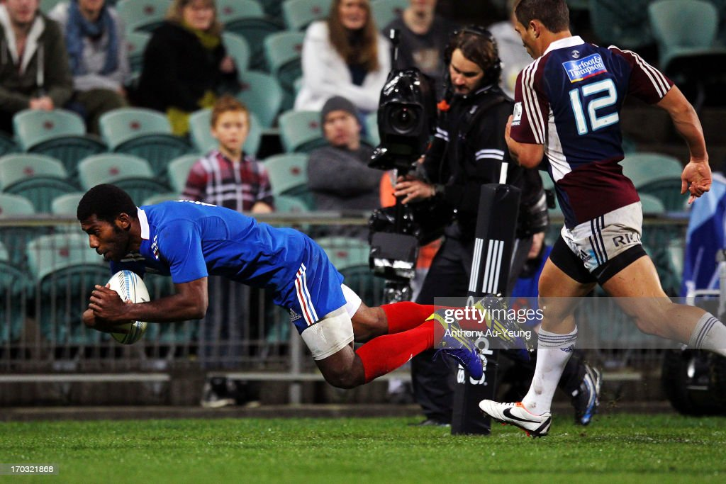 Noa Nakaitaci of France scores a try during the tour match between the Auckland Blues and France at North Harbour Stadium on June 11, 2013 in Auckland, New Zealand.