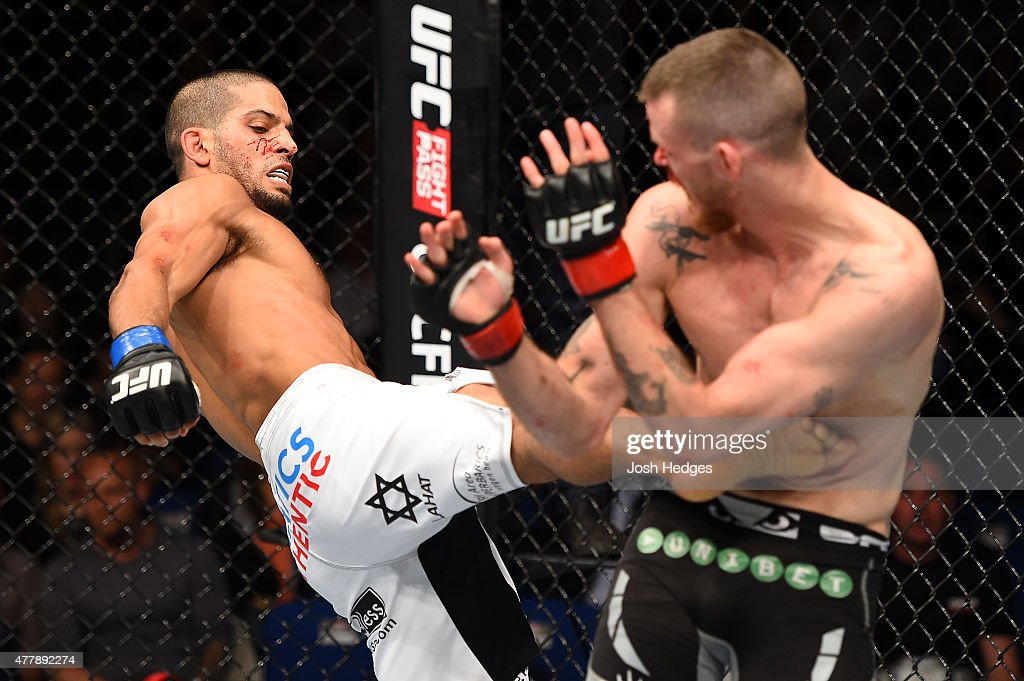 Noad Lahat of Israel kicks Niklas Backstrom of Sweden in their featherweight bout during the UFC Fight Night event at the O2 World on June 20 2015 in...