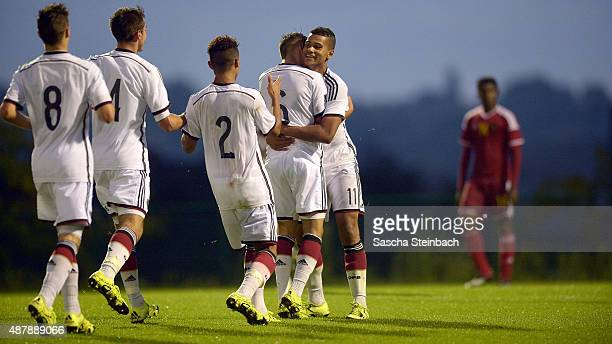 Noah Awuku of Germany celebrates with team mates after scoring his team's third goal during the U16 international friendly match between Belgium and...